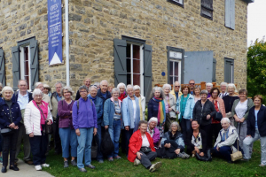 Participants in the HSO's fall excursion to Vankleek Hill and Pointe Fortune gather outside historic Macdonell-Williamson House, an exceptional example of Georgian architecture built in 1817-1819 by fur trader John Macdonnell. The house has 12 fireplaces.